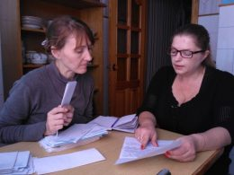 Tatiana Mironova and Irina Kravets examining documents of the state officials on Elvira's case